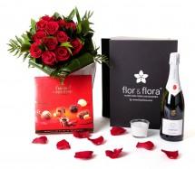 Caja regalo 12 rosas rojas + vela + cava + regalo