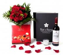 Caja regalo 12 rosas rojas + vela + vino Rioja + regalo