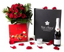 Caja regalo 15 rosas rojas + vela + cava + regalo